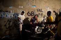 Rocinha residents, the biggest favela in Brazil, with over 100,000 residents, in Rio de Janeiro, Br., on Thursday, Jan. 24, 2013. In early November 2011 about 3,000 police officers and soldiers moved into one of the largest slums in Latin America in an effort by the Brazilian government to assert control over lawless areas of the city ahead of the 2014 World Cup and 2016 Summer Olympics.