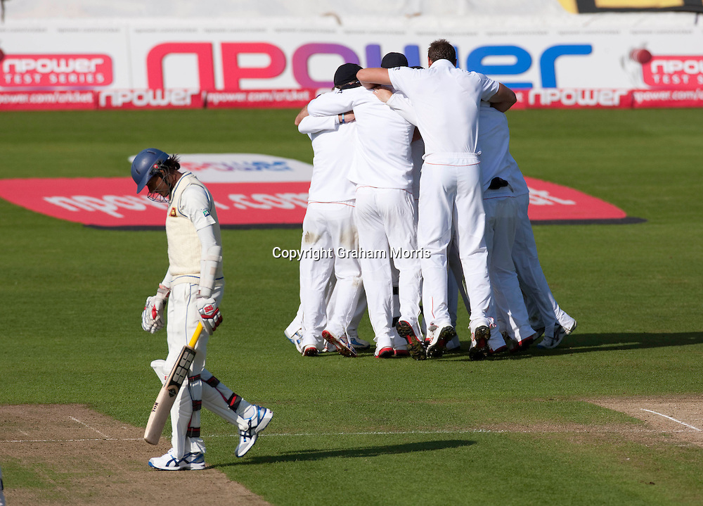Celebrations as last man Suranga Lakmal (left) is out off the bowling of Stuart Broad as England win the first npower Test Match against Sri Lanka at the SWALEC Stadium, Cardiff.  Photo: Graham Morris (Tel: +44(0)20 8969 4192 Email: sales@cricketpix.com) 30/05/11