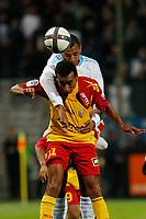 FOOTBALL - FRENCH CHAMPIONSHIP 2010/2011 - L1 - OLYMPIQUE MARSEILLE v RC LENS - 13/11/2010 - PHOTO PHILIPPE LAURENSON / DPPI - EDOUARD CISSE (OM) / DOS SANTOS (LEN)