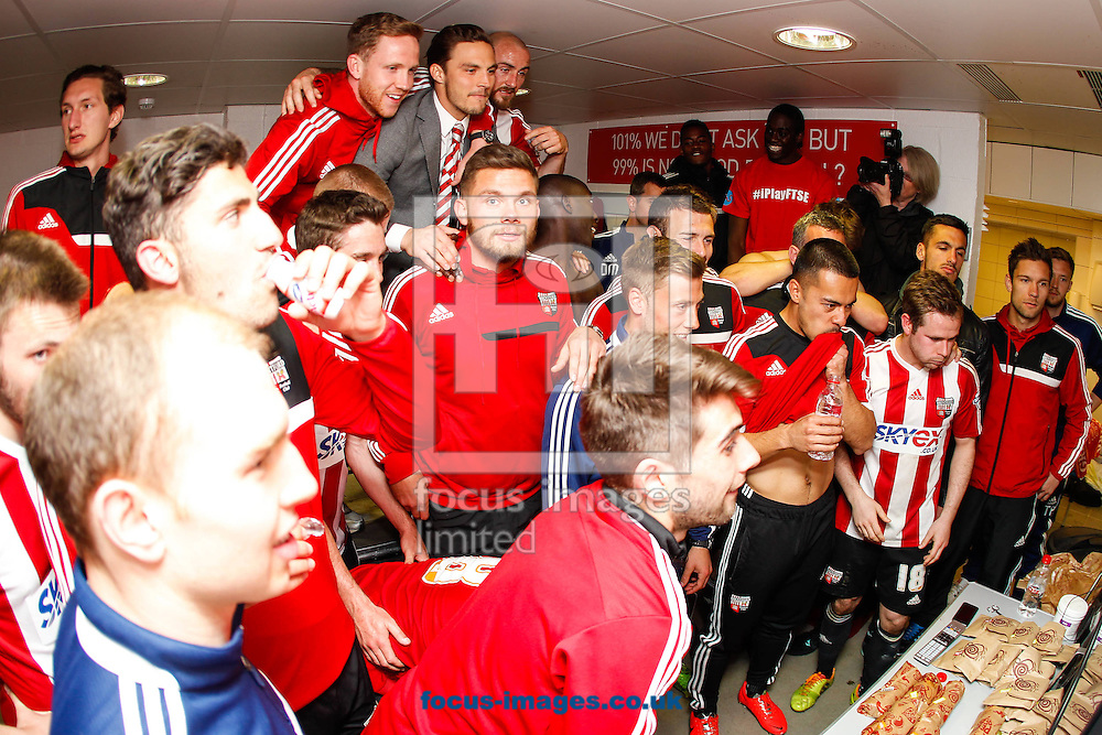 Brentford players await the result from Molineux after the game against Preston North End at Griffin Park, London<br /> Picture by Mark D Fuller/Focus Images Ltd +44 7774 216216<br /> 18/04/2014