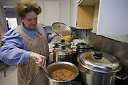 "Aug 10, 2008 -- COLORADO CITY: Women in the Jessop family prepare the family dinner in their home in Colorado City, AZ. The Jessops are polygamists and members of the FLDS. Colorado City and neighboring town of Hildale, UT, are home to the Fundamentalist Church of Jesus Christ of Latter Day Saints (FLDS) which split from the mainstream Church of Jesus Christ of Latter Day Saints (Mormons) after the Mormons banned plural marriage (polygamy) in 1890 so that Utah could gain statehood into the United States. The FLDS Prophet (leader), Warren Jeffs, has been convicted in Utah of ""rape as an accomplice"" for arranging the marriage of teenage girl to her cousin and is currently on trial for similar, those less serious, charges in Arizona. After Texas child protection authorities raided the Yearning for Zion Ranch, (the FLDS compound in Eldorado, TX) many members of the FLDS community in Colorado City/Hildale fear either Arizona or Utah authorities could raid their homes in the same way. Older members of the community still remember the Short Creek Raid of 1953 when Arizona authorities using National Guard troops, raided the community, arresting the men and placing women and children in ""protective"" custody. After two years in foster care, the women and children returned to their homes. After the raid, the FLDS Church eliminated any connection to the ""Short Creek raid"" by renaming their town Colorado City in Arizona and Hildale in Utah.Photo by Jack Kurtz / ZUMA Press"