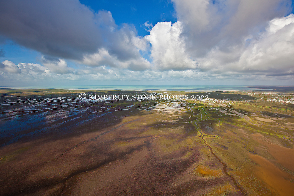 Wet season rain clouds cast dramatic shadows over Roebuck Plains in the Kimberley wet season.  Water from the plains drains into Roebuck Bay, bringing an inundation of fresh water.