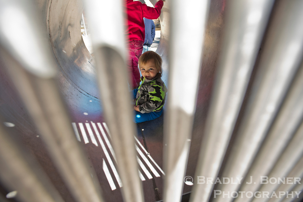 Alex Martinez, 2, explores the inside of a bear trap Saturday during Junior Ranger Day at the Craig Thomas Discovery and Visitor Center in Grand Teton National Park.