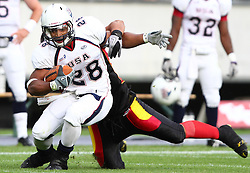 10.07.2011, Tivoli Stadion, Innsbruck, AUT, American Football WM 2011, Group A, Germany (GER) vs United States of America (USA), im Bild tackle from Jasson Scott (Germany, #9, LB) against Da'Shawn Thomas (USA, #28, RB)  // during the American Football World Championship 2011 Group A game, Germany vs USA, at Tivoli Stadion, Innsbruck, 2011-07-10, EXPA Pictures © 2011, PhotoCredit: EXPA/ T. Haumer