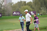 Hootong Li on his way to winning, Rory McIlroy wins with on the 18th green<br /> Omega Dubai Desert Classic 2018<br /> <br /> Golf Pictures Credit by: Mark Newcombe / visionsingolf.com Hootong Li on his way to winning Haotong Li on his way to winning