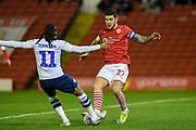 Barnsley FC Captain Alex Mowatt (27) and Daniel Johnson (11) of Preston North End FC compete for the ball during the EFL Sky Bet Championship match between Barnsley and Preston North End at Oakwell, Barnsley, England on 21 January 2020.