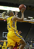 December 09 2010: Iowa guard Jaime Printy (24) puts up a shot during the first half of their NCAA basketball game at Carver-Hawkeye Arena in Iowa City, Iowa on December 9, 2010. Iowa defeated Iowa State 62-40 in the Hy-Vee Cy-Hawk Series rivalry game.