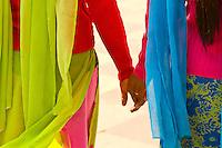 Indian women in colorfuls saris walking and holding hands, the Taj Mahal, Agra, Uttar Pradesh, India