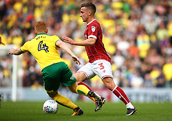 Joe Bryan of Bristol City goes past Harrison Reed of Norwich City - Mandatory by-line: Robbie Stephenson/JMP - 23/09/2017 - FOOTBALL - Carrow Road - Norwich, England - Norwich City v Bristol City - Sky Bet Championship