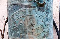 Leverano (Le) - Particolare di un irroratore appeso su un muro nel centro storico.