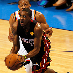 Jun 14, 2012; Oklahoma City, OK, USA;  Miami Heat point guard Mario Chalmers (15) drives to the basket against Oklahoma City Thunder point guard Russell Westbrook (0) during the first quarter of game two in the 2012 NBA Finals at Chesapeake Energy Arena. Mandatory Credit: Derick E. Hingle-US PRESSWIRE