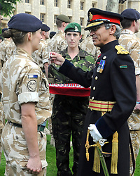© under license to London News Pictures. 08/01/2011. General Cima pictured R), the Governor of The Tower of London has been removed from his position following a disciplinary investigation. No explanation has been given. Maj Gen Cima was appointed in 2006. PICTURED ON 21/05/2010 General Cima addresses the crowd at an historic medal presentation at the Tower of London. It is the first presentation of its kind ever to be held there. 150 mainly Royal Signals Officers and Soldiers who have just returned from Afghanistan were presented their Afghan Medals by General Cima, the Governor of The Tower of London. Picture credit should read Stephen Simpson/London News Pictures