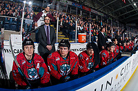 KELOWNA, CANADA - MARCH 16: Kaedan Korczak #6, Assistant coach Kris Mallette, Dalton Gally #3 and Leif Mattson #28 of the Kelowna Rockets stand on the bench against the Vancouver Giants  on March 16, 2019 at Prospera Place in Kelowna, British Columbia, Canada.  (Photo by Marissa Baecker/Shoot the Breeze)