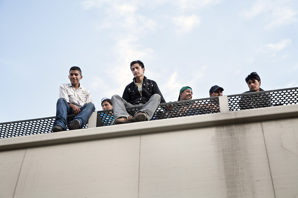 "Migrants from central America on the top of ""the Beast"".Ixtepec railway station. Oxaca-Mexico,2011"