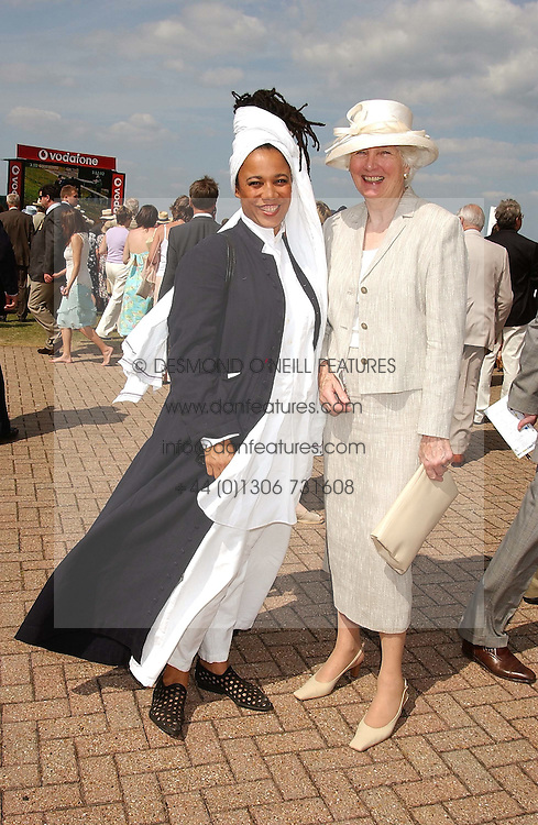 Left to right, MRS GAVIN BURKE, she is actress Mimi March adopted daughter of the Duke of Richmond and BRONWEN, VISCOUNTESS ASTOR at the 4th day of the annual Glorious Goodwood horseracing festival held at Goodwood Racecourse, West Sussex on 30th July 2004.