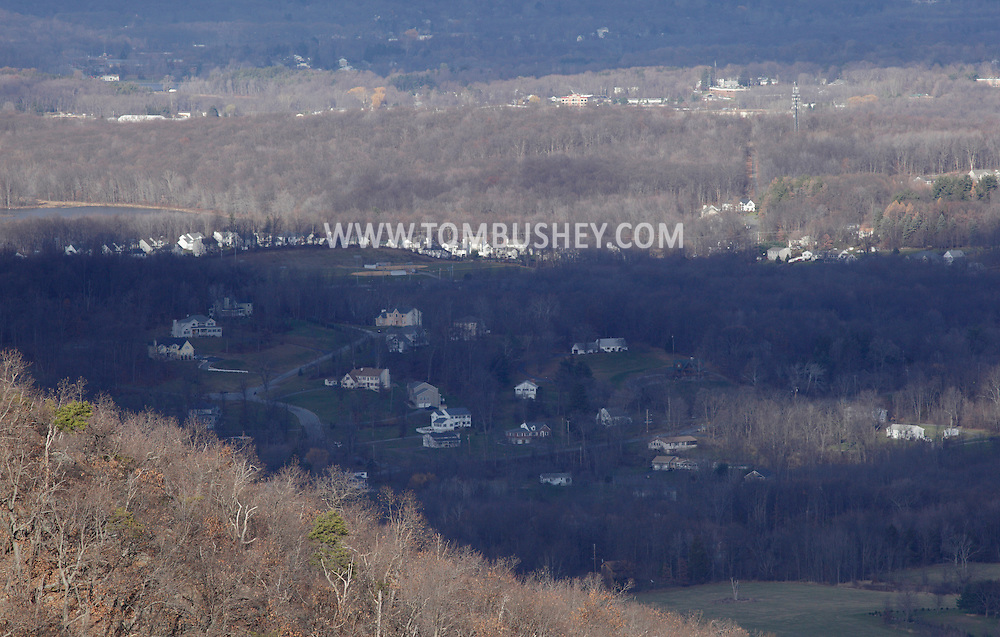 Mountainville, New York - A view of Schunnemunk Mountain's western ridge, in foreground, and suburban homes in the background as seen from the eastern ridge on Nov. 28, 2010.