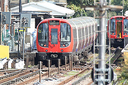 Forensic officers inspect the carriage which carried the terrorist bomb at parsons green tube station<br />