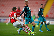 Aapo Halme of Barnsley clears the ball under pressure from Swansea City forward Sam Surridge (19) during the EFL Sky Bet Championship match between Barnsley and Swansea City at Oakwell, Barnsley, England on 19 October 2019.