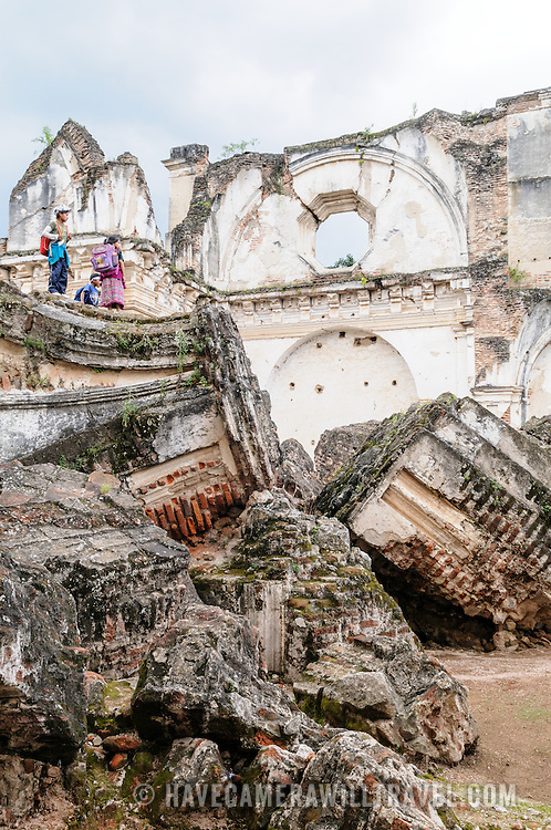 Some kids stand on the ruins of the Iglesia y Convento de La Recolección in Antigua, Guatemala. The church was destroyed by the earthquake of 1773.