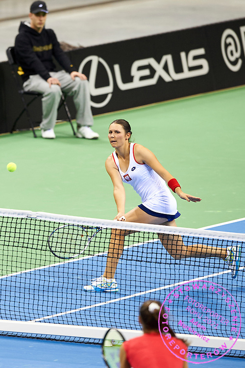 Klaudia Jans Ignacik from Poland in action during Second Day of the Fed Cup / World Group 1st round tennis match between Poland and Russia at Tauron Krakow Arena on February 8, 2015 in Cracow, Poland.<br /> <br /> Poland, Cracow, February 8, 2015<br /> <br /> Picture also available in RAW (NEF) or TIFF format on special request.<br /> <br /> For editorial use only. Any commercial or promotional use requires permission.<br /> <br /> Adam Nurkiewicz declares that he has no rights to the image of people at the photographs of his authorship.<br /> <br /> Mandatory credit:<br /> Photo by &copy; Adam Nurkiewicz / Mediasport