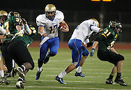 Wahlert's Sam Koenig (17) runs through a hole during the first half of the game between Cedar Rapids Kennedy and Dubuque Wahlert at Kingston Stadium in Cedar Rapids on Friday night, October 21, 2011.