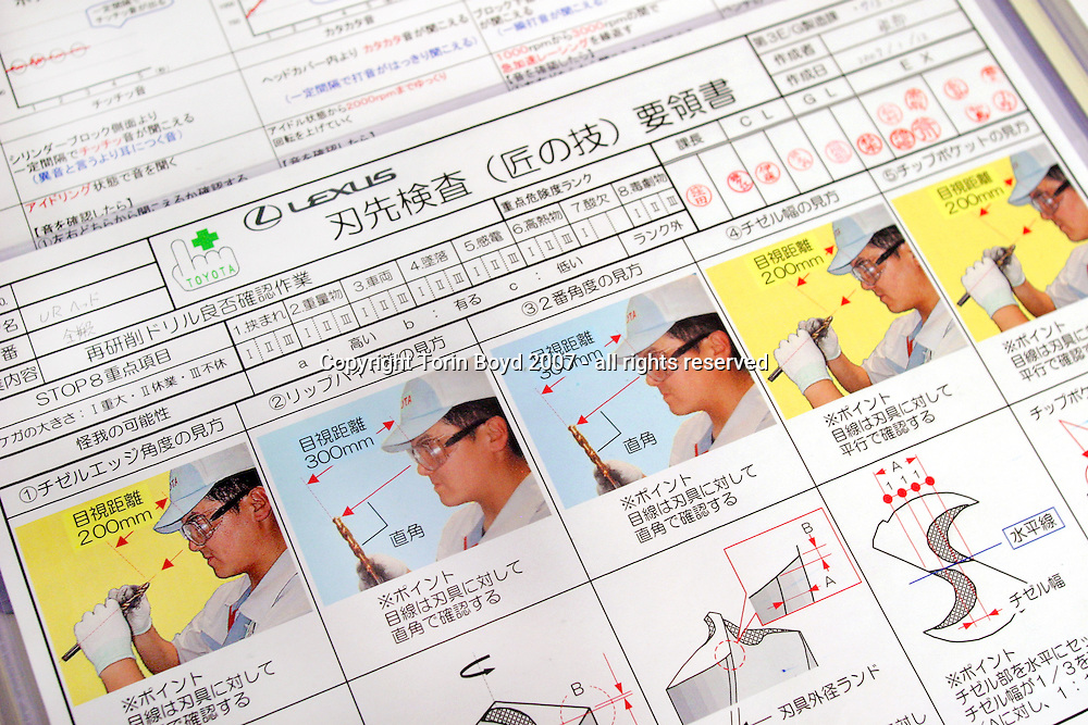 """This is part of the training studio or martial arts style """"dojo"""" at Toyota Motor Corp.'s Tahara plant in Aichi Prefecture (this image shows a checklist). Here Lexus workers are trained to detect the smallest flaws and defects that robots and computers can't detect. Something like a martial arts class, this training is where workers are taught mental skills like how to gauge bolt tightening or how to insert parts on the line just right. They are also ranked by their skill level and are tested every four months for technique. These skill levels include: Master Craftsmen, Assistant Master Craftsmen, and Craftsmen. According to Toyota management, workers are trained for body and mind which is reflected in the quality of their product. Some of the training includes finger exercises with specially designed rubber nets, the arranging of colors patterns, and feeling tests while wearing cotton gloves. This is in addition to the classrooms training where workers are drilled on the concept of perfection. Besides the Lexus LS, GS and IS sedans manufactured here (hybrids included), Toyota also makes the Land Cruiser Prado, 4 Runner and RAV4 sport vehicles."""
