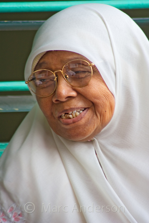 Malaysian woman wearing a traditional Islamic head covering..