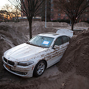 November 6, 2012 - Brooklyn, NY : Storm-damaged cars sit in piles of sand near the intersection of Ocean Parkway and Surf Avenue in Coney Island on Tuesday as the region contines to clean up in the wake of Superstorm Sandy. CREDIT: Karsten Moran for The New York Times