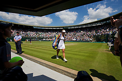 LONDON, ENGLAND - Wednesday, July 2, 2014: Angelique Kerber (GER) walks off court dejected during the Ladies' Singles Quarter-Final match on day nine of the Wimbledon Lawn Tennis Championships at the All England Lawn Tennis and Croquet Club. (Pic by David Rawcliffe/Propaganda)