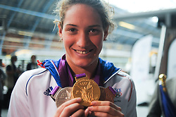 © Licensed to London News Pictures. 13/08/2012. London,Britain.French's Camile Muffat  pose with their gold medals at St. Pancras International as they leave the UK to head home following the 2012 Olympic games.  Photo credit : Thomas Campean/LNP