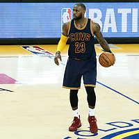 01 June 2017: Cleveland Cavaliers forward LeBron James (23) dribbles during the Golden State Warriors 113-90 victory over the Cleveland Cavaliers, in game 1 of the 2017 NBA Finals, at the Oracle Arena, Oakland, California, USA.