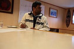 DAVIS STRAIT ABOARD ESPERANZA 16JUN11 - Greenpeace International executive director Kumi Naidoo of South Africa prepares to take action on the Greenpeace ship Esperanza in the Davis Stait off the coast of Greenland...Photo by Jiri Rezac / Greenpeace