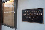 A sign in front of Jimmie Kramer's Peanut Bar hangs next to an empty sign holder which reflects the Reading Eagle, which is set to go on the auction block Wednesday, May 15, 2019 at Jimmie Kramer's The Peanut Bar in Reading, Pennsylvania. WILLIAM THOMAS CAIN / For The Inquirer