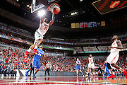 LOUISVILLE, KY - DECEMBER 29: Chane Behanan #21 of the Louisville Cardinals dunks the ball on a fast break against the Kentucky Wildcats at the KFC Yum! Center in Louisville, Kentucky. Louisville won 80-77. (Photo by Joe Robbins)