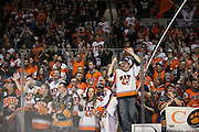 RIT fans celebrate after the men's hockey team defeated Robert Morris University to win the Atlantic Hockey final at the Blue Cross Arena in Rochester on Saturday, March 19, 2016.