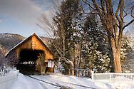 Middle Bridge, a covered wooden bridge in winter.  Woodstock, Vermont U.S.