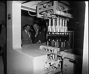 """New Bottling plant for D.E.Williams..1975..19.06.1975..06.19.1975..19th June 1975..The Minister for Justice, Mr Patrick Cooney TD, officially opened the new one and a half million gallon per annum soft drink facility at Tullamore,Co Offaly. The new plant represents an investment of over a quarter million pounds by the Williams Group. It is hoped that this investment will create further employment for the area...The Minister,Mr Patrick Cooney and Mr W J Ralph are pictured watching the operation of the """"crating"""" equipment."""