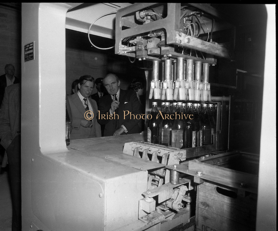 "New Bottling plant for D.E.Williams..1975..19.06.1975..06.19.1975..19th June 1975..The Minister for Justice, Mr Patrick Cooney TD, officially opened the new one and a half million gallon per annum soft drink facility at Tullamore,Co Offaly. The new plant represents an investment of over a quarter million pounds by the Williams Group. It is hoped that this investment will create further employment for the area...The Minister,Mr Patrick Cooney and Mr W J Ralph are pictured watching the operation of the ""crating"" equipment."