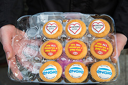 London, UK. 13th February, 2019. Strike-themed cup cakes prepared by Public & Commercial Services (PCS) union members in solidarity with outsourced workers who walked out from the Department of Business, Energy and Industrial Strategy (BEIS) for their second day of strike action to demand the London Living Wage and an end to outsourcing. Union members handed out strike-themed cakes to supporters in return for donations to the strike fund.