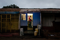 Nairobi, Kenya. 2013<br /> <br /> <br /> Most businesses remain closed on election day, but one barber shop was opened before 7:30 a.m in the Kibera slums, Nairobi, Kenya.