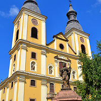 St. Bernard&rsquo;s Cistercian Church in Eger, Hungary<br /> After the expulsion of the occupying Turks in 1687, their mosques were destroyed and gradually replaced with Catholic churches. The Jesuits were among the first to construct a monastery in the late 17th century. In 1700, they began building St. Bernard&rsquo;s Church. The Baroque design of Stephen Pethὄ featuring two towers was finished in 1743. The Jesuits only worshiped here a few years before their order was abolished by Holy Roman Emperor Joseph II. The church was then turned over to the Cistercians until they were similarly expelled in 1787. 202 years later, the Cistercians regained procession. The structure has been rebuilt twice: in 1888 and again in 1902.