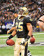 New Orleans SAinst RB Reggie Bush looks disapointed after getting a first down but no touchdown in the game against the St. Louis Rams. The Saints went on to win 31-13 against the St. Louis Ram.The New Orleans Saints play the St. Louis rams in New Orleans at the Super Dome Sunday Dec. 12,2010. Photo©SuziAltman. Singer and actress MILEY CYRUS poses for a fan's camera phone with New Orleans police officers on the sidelines prior to The New Orleans Saints' kickoff against the St. Louis Rams at the Superdome. Cyrus is currently filming ''So Undercover'' in New Orleans.