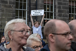 A Peace vigil has been held at a Sikh temple in the Leith district of Edinburgh. The vigil, called by the Muslim Women's Association of Edinburgh and supported by Stand up to Racism Edinburgh, follows a fire at the temple. A 49 year-old man has been charged over the incident.<br /> <br /> Pictured: A local child holding a banner during the vigil