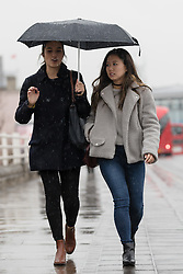 © Licensed to London News Pictures. 03/03/2017. LONDON, UK.  People are caught in heavy rain showers near Waterloo on the South Bank in London this morning.  Photo credit: Vickie Flores/LNP