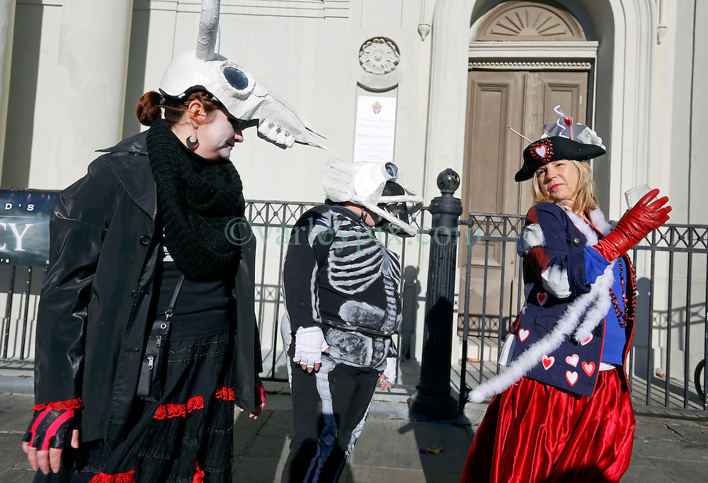 09 February 2016. New Orleans, Louisiana.<br /> Mardi Gras Day. Checking costumes in  Jackson Square in the French Quarter.<br /> Photo©; Charlie Varley/varleypix.com