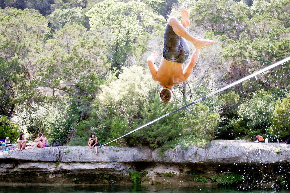 Dan throws multiple backflips with ease on a warm Texas afternoon.<br /> Sculpture Falls, Texas