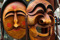 Traditional carved wooden masks for sale in an art shop in Insadong district of Seoul South Korea