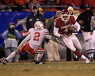 University of Oklahoma wide receiver Malcolm Kelly (4) cuts up field by Nebraska defensive back Cortney Grixby (2) in the second half, during the Big 12 Championship game at Arrowhead Stadium in Kansas City, Missouri, December 2, 2006.  Oklahoma beat Nebraska 21-7.<br />