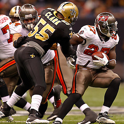 January 2, 2011; New Orleans, LA, USA; Tampa Bay Buccaneers running back LeGarrette Blount (27) is pursued by New Orleans Saints linebacker Danny Clark (55) during the second quarter at the Louisiana Superdome. Mandatory Credit: Derick E. Hingle
