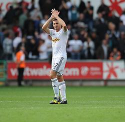 Swansea City's Angel Rangel claps the home fans after making his 100th Premier League appearance  - Photo mandatory by-line: Alex James/JMP - Mobile: 07966 386802 30/08/2014 - SPORT - FOOTBALL - Swansea - Liberty Stadium - Swansea City v West Brom - Barclays Premier League